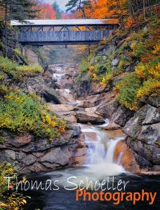 White Mountain Puzzles Inc releases Thomas Schoeller autumn covered bridge design